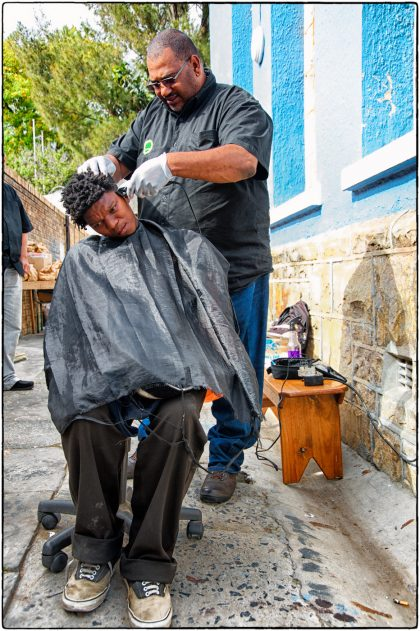 Fieldworker Mark Williams cutting hair.