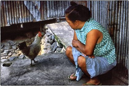 Woman with hen, Philippines - Gerry Atkinson